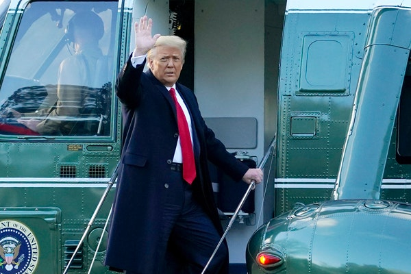 President Donald Trump waves as he boards Marine One on the South Lawn of the White House, this morning in Washington. Trump is en route to his Mar-a-