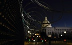 Razor wire is seen at a security checkpoint the night before the 59th Presidential Inauguration at the U.S. Capitol in Washington, Tuesday, Jan. 19, 2