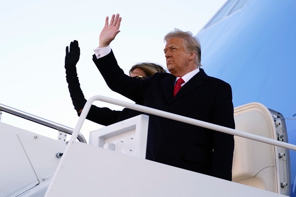 President Donald Trump and first lady Melania Trump board Air Force One at Andrews Air Force Base, Md., Wednesday, Jan. 20, 2021.