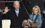 Joe Biden is sworn in as the 46th president of the United States by Chief Justice John Roberts as Jill Biden holds the Bible at the U.S. Capitol on We