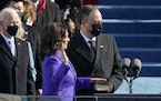 Kamala Harris is sworn in as vice president by Supreme Court Justice Sonia Sotomayor as her husband Doug Emhoff holds the Bible during the 59th presid