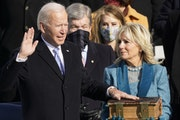 Joe Biden is sworn in as the 46th president of the United States by Chief Justice John Roberts as Jill Biden holds the Bible on Wednesday at the U.S.
