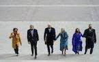 From left, Amy Klobuchar, D-Minn., Sen. Roy Blunt, R-Mo., President-elect Joe Biden, Jill Biden, Vice President-elect Kamala D. Harris and Doug Emhoff