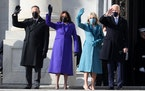 From left, Doug Emhoff, U.S. Vice President-elect Kamala Harris, Jill Biden and President-elect Joe Biden wave as they arrive on the East Front of the