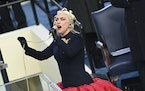 Lady Gaga sings the national anthem at the beginning of the swearing-in ceremony for President Joe Biden at the U.S. Capitol in Washington, Wednesday,