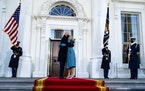 President Joe Biden and first lady Jill Biden embrace in front of the White House in Washington during the Presidential Escort.