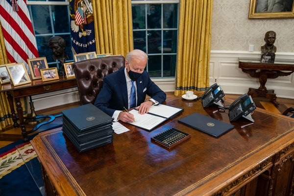 President Joe Biden signed executive orders during his first minutes in the Oval Office on Wednesday.