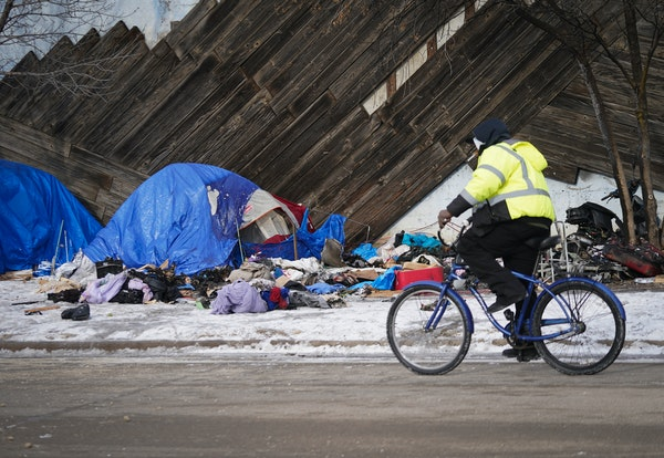 Crews cleaned up a homeless encampment on Shepard Road in St. Paul, where fire Wednesday morning left one person dead and another injured.