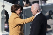 Sen. Amy Klobuchar, D-Minn., celebrates with U.S. President Joe Biden as he prepares to deliver his inaugural address on the West Front of the U.S. Ca