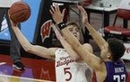 Wisconsin's Tyler Wahl shoots over Northwestern's Pete Nance during the second half