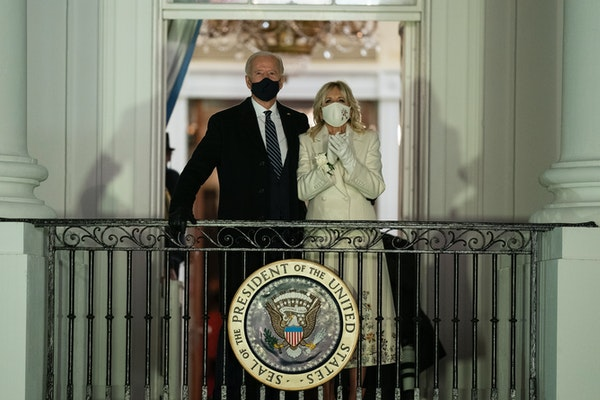 President Joe Biden and First Lady Jill Biden watch fireworks from the White House on Wednesday night.