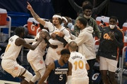 Teammates rushed to congratulate Magic guard Cole Anthony (50) after he hit a three pointer over Timberwolves guard Malik Beasley that won the game.