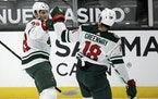 Wild left wing Ryan Hartman, left, celebrates his goal with left wing Jordan Greenway against the Anaheim Ducks during the first period
