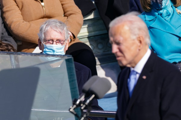 Senate Majority Leader Mitch McConnell, R-Ky., looked on as U.S. President Joe Biden delivers his inaugural address on the West Front of the U.S. Capi