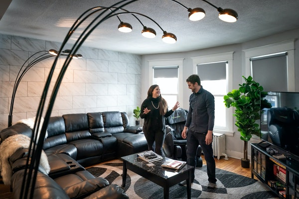 Anthony Aguirre and his wife, Brooke, in one of their Minneapolis short-term rental homes.  (Staff photo by GLEN STUBBE • glen.stubbe@startribune.co