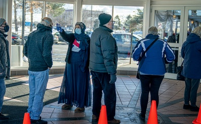 People with appointments waited for their entry times Thursday at a vaccination site in Brooklyn Center, one of nine test clinics across Minnesota tha