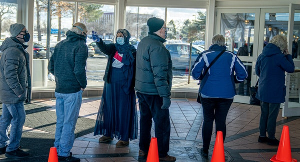 People with appointments for COVID-19 vaccinations in Brooklyn Center waited Thursday for their entry times. They were allowed in five at a time for s