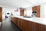 Kitchen trends include big islands with plenty of storage.