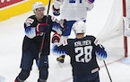 United States' Matthew Boldy and Arthur Kaliyev  celebrate a goal against Slovakia during the world junior tournament in Edmonton.