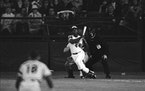 Hank Aaron eyes the flight of the ball after hitting his 715th career homer in a game against the Los Angeles Dodgers in Atlanta, Ga., Monday night, A