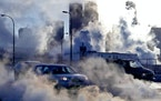 The collision of cold air and heat from car exhaust and steam from buildings is visible in Minneapolis.