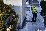 Law enforcement officers investigate the scene on Payne Ave. N. at North St. where a shooting left two people dead Thursday in St. Paul.    ]DAVID JOL