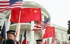 It was once thought that China would become more like the U.S., but now it looks as though the U.S. is becoming more like China. Above, a military hon