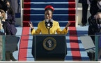 National youth poet laureate Amanda Gorman recites her inaugural poem during the 59th Presidential Inauguration at the U.S. Capitol in Washington on J
