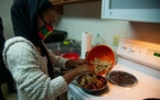 University of Minnesota student Zubeda Chaffe cooks cacabsa with other members of the Oromo Student Union. Cacabsa, a traditional Sudanese dish made o