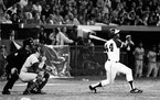 Atlanta Braves' Hank Aaron (44) breaks Babe Ruth's record for career home runs as he hits his 715th off Los Angeles Dodgers pitcher Al Downing in