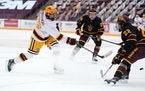 Gophers forward Bryce Brodzinski took a shot on goal as Arizona State defenseman Jack Judson defended on Friday evening. The Gophers won in a rout, 10