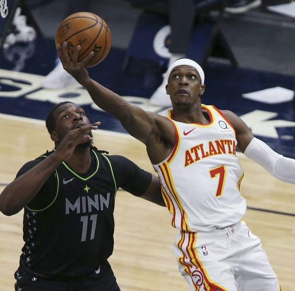 The Wolves' Naz Reid, at 6-9, appeared frozen while 6-1 Hawks guard Rajon Rondo slashed his way to the basket for a scoring attempt in the first hal