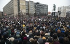 People gather in Pushkin Square during a protest against the jailing of opposition leader Alexei Navalny in Moscow, Russia, Saturday, Jan. 23, 2021.