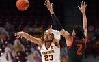 Minnesota forward Brandon Johnson (23) passed the ball off as Maryland guard Aaron Wiggins (2) defended in the first half.