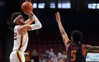 Minnesota guard Gabe Kalscheur took an outside shot as Maryland guard Eric Ayala reached to block in the first half.