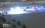 The crash scene on I-694 in Arden Hills where a state trooper was injured Saturday night.