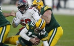 The Buccaneers' Shaquil Barrett sacked Packers quarterback Aaron Rodgers during the second half of the NFC Championship Game on Sunday.