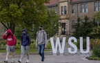 Students walked on the campus of Winona State University in September.  CARLOS GONZALEZ • cgonzalez@startribune.com