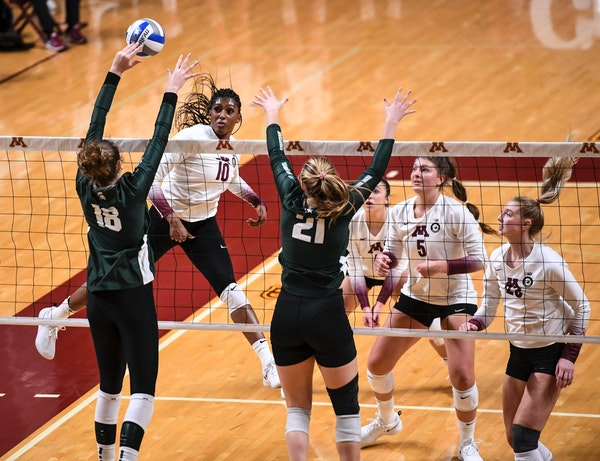 Opposite hitter Stephanie Samedy (shown Saturday against Michigan State) led the Gophers over the Spartans for a second consecutive day Sunday, winnin