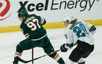 Minnesota Wild left wing Kirill Kaprizov (97) made a nifty move between his legs toward the net in the third period as San Jose Sharks left wing Marcu