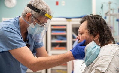 Dr. Todd Struckman examined Neil Adamson, who was experiencing throat swelling, on Thursday at St. Luke's in Duluth.