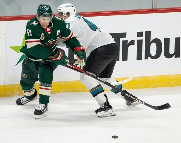 Wild winger Zach Parise and the Sharks' John Leonard fought for the puck in the second period. Parise scored the game's first goal, but the Sharks