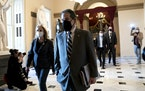 In this file photo, House Impeachment Managers Rep. Jamie Raskin (D-MD) (R) and Rep. Madeleine Dean (D-PA) wear protective masks while walking to the