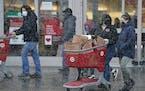 Shoppers in December 2020 at a Target Super Store in Richfield. (DAVID JOLES/ david.joles@startribune.com)