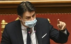 Premier Giuseppe Conte delivers his speech at the Senate, in Rome, Tuesday, Jan. 19, 2021. Conte fights for his political life with an address aimed a