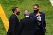 Vikings team president Mark Wilf, left, chairman Zygi Wilf, center, and general manager Rick Spielman.