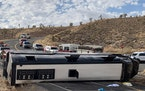 This photo provided by the Mohave County Sheriff's Office shows a Las Vegas-based tour that rolled over in northwestern Arizona on Friday, Jan. 22,