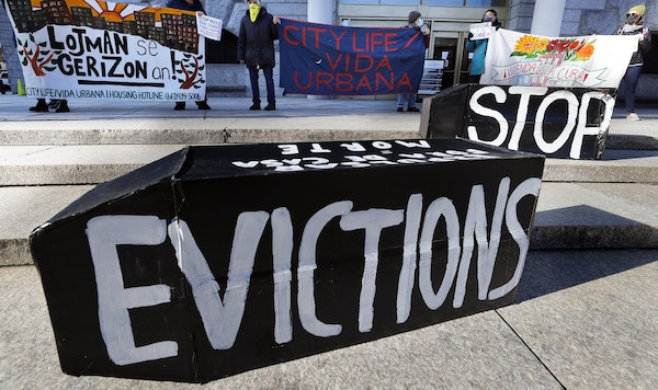 Tenants' rights advocates demonstrate in Boston on Jan. 13. The protest was part of a national day of action calling on the Biden administration to