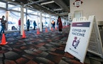 Minnesotans line up to receive the COVID-19 vaccine at the state's Brooklyn Center site on Jan. 21.