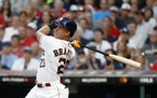 Outfielder Michael Brantley agreed to a $32 million, two-year contract to stay with the Astros.